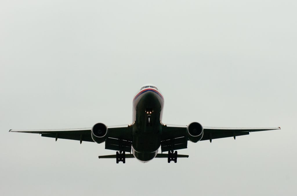 Low Angle View Of Airplane Against Clear Sky