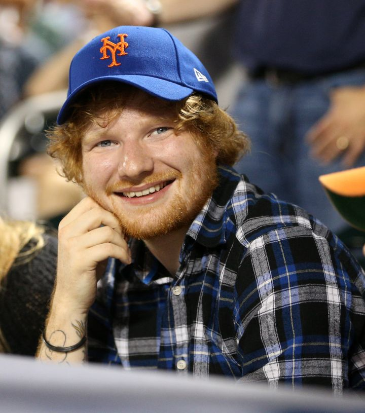 Our boy Ed Sheeran flashes a smile while out with his mystery lady, this time at the Philadelphia Phillies Vs. New York Mets game. We didn't show her because we respect his privacy.