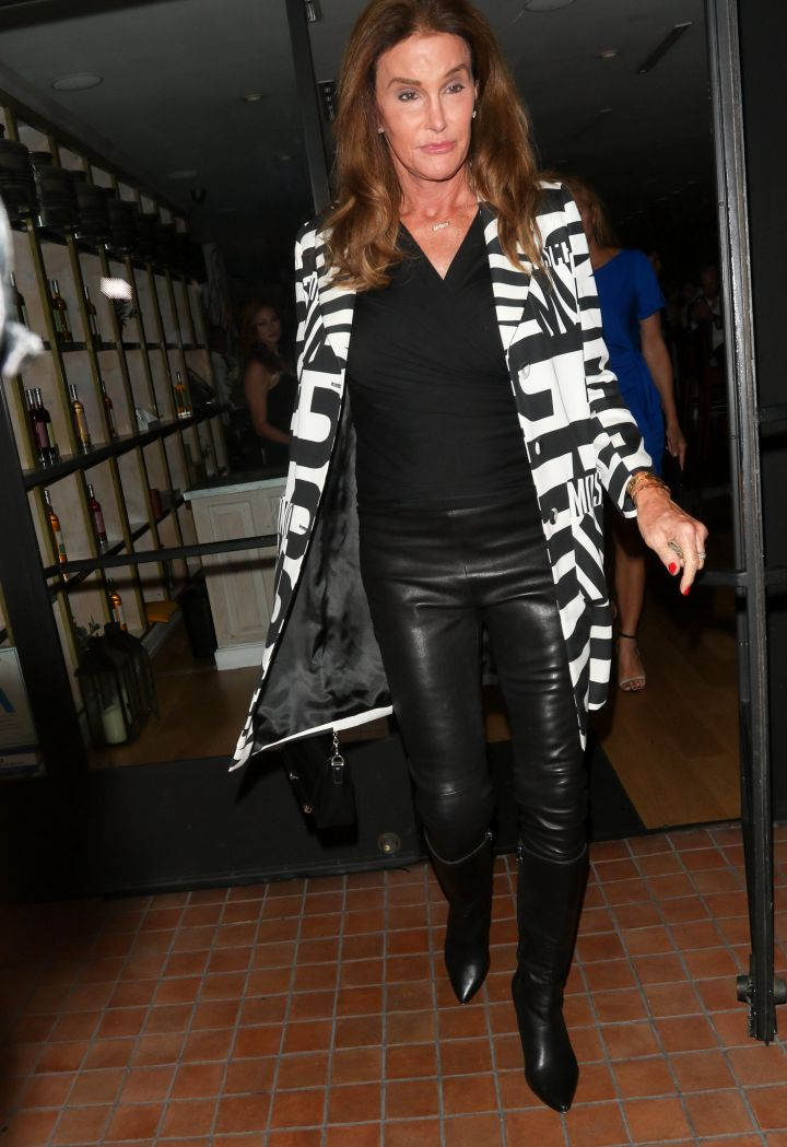 Caitlyn Jenner sashayed in a long coat while dining at Fig and Olive in L.A.