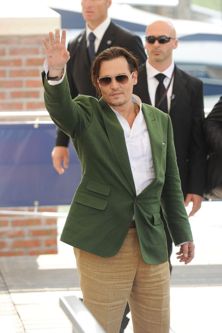 """""""Black Mass"""" star Johnny Depp waved to screaming fans at the 72nd Venice Film Festival."""