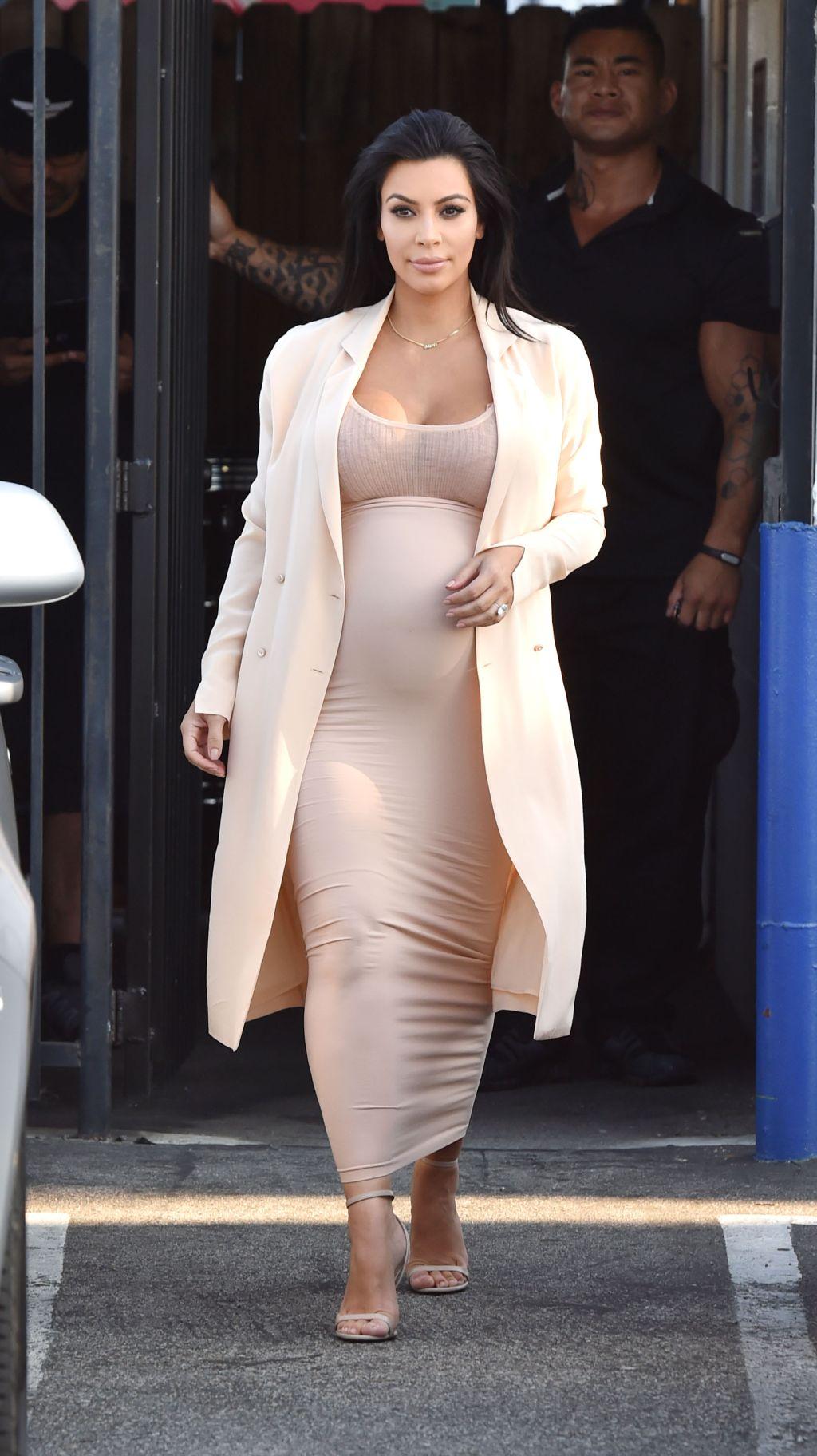 A pregnant Kim Kardashian leaves the studio