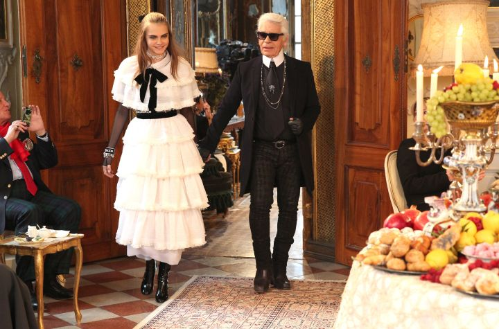 Cara Delevingne and Karl at his Chanel show. Cara is always his main model gal.