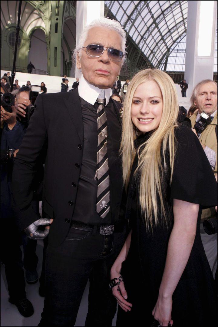 Avril Lavigne put on a smile for Karl.