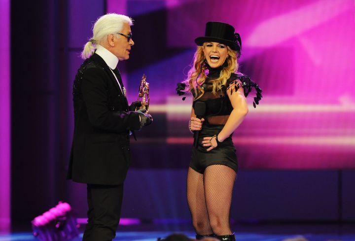 Karl honoring Britney Spears on stage.