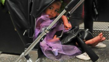 Kim Kardashian walks north west in a purple princess dress