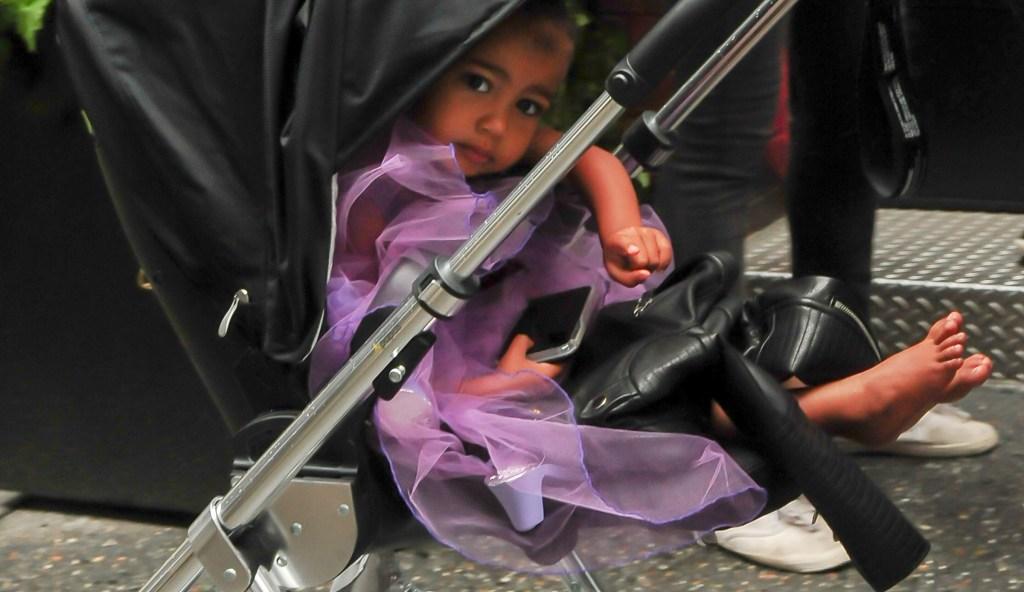 Kim Kardashian walks north west in a purple princess dress