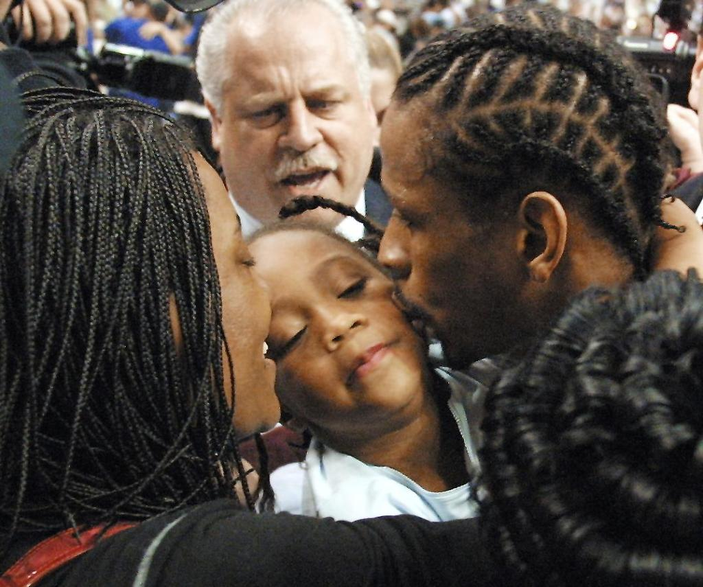 Philadelphia 76ers' Allen Iverson (R) kisses his d