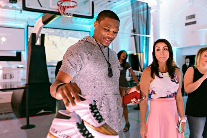 Russell Westbrook checking out the new EA Sports sneaks.
