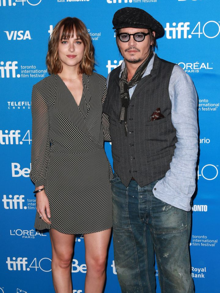 "Dakota Johnson and Johnny Depp posed for a picture together at the premiere of their film ""Black Mass"" at TIFF."