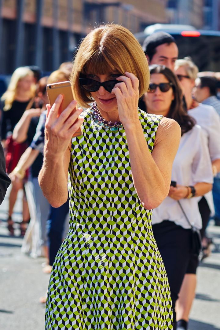 Anna Wintour was spotted checking her text messages outside the Ralph Lauren fashion show during New York Fashion Week.
