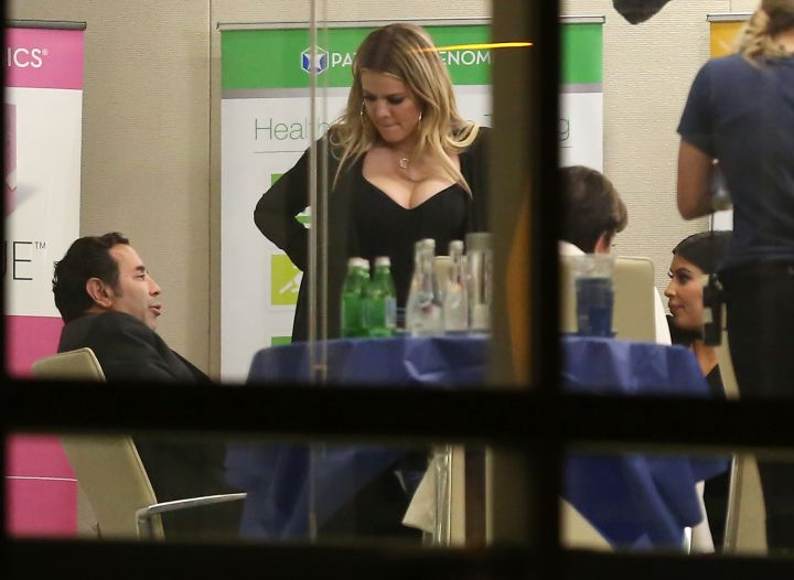"This is interesting. Pregnant Kim Kardashian and sis Khloe Kardashian have a meeting with ""Botched"" plastic surgeon Paul S. Nassif, MD in L.A."