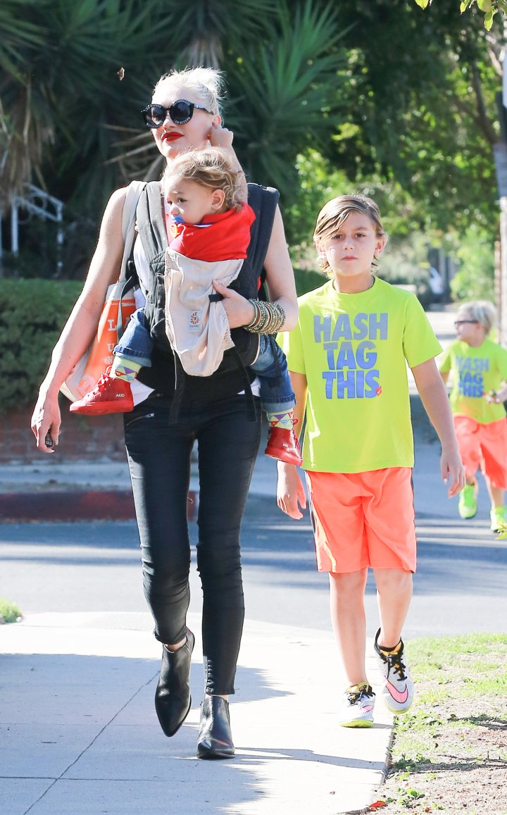 Gwen Stefani takes her children to church, but if you look closely, one of them didn't think she was serious about leaving him behind.