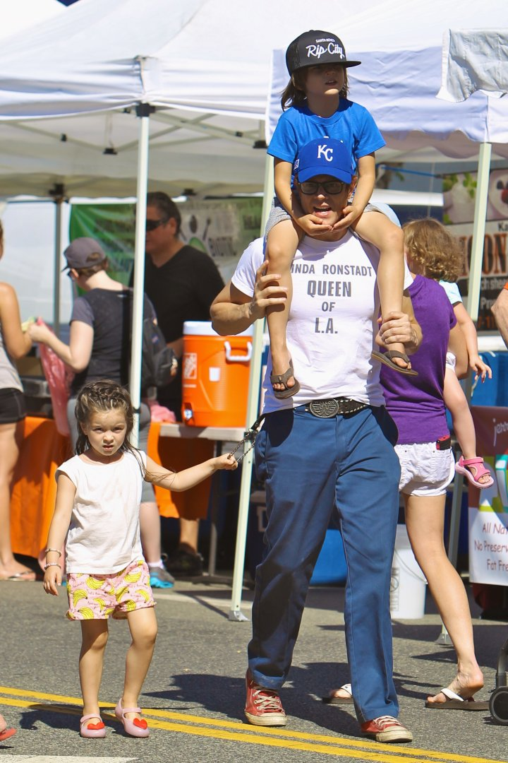 Johnny Knoxville gave his son Rocko a ride on his shoulders, while his daughter Arlo held onto his wallet chain through the busy Studio City Farmers Market.