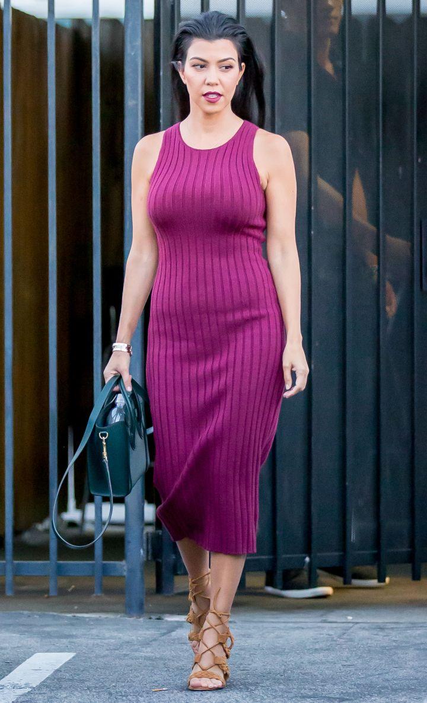 Kourtney Kardashian showed off her MILF-y figure at a studio in Los Angeles, CA.