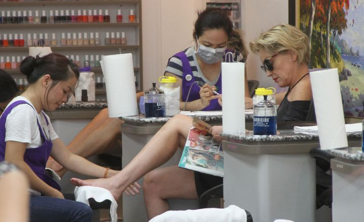Sharon Stone is such a superstar, she wears shades and reads indoors while getting her feet done at a nail salon in Beverly Hills, CA.