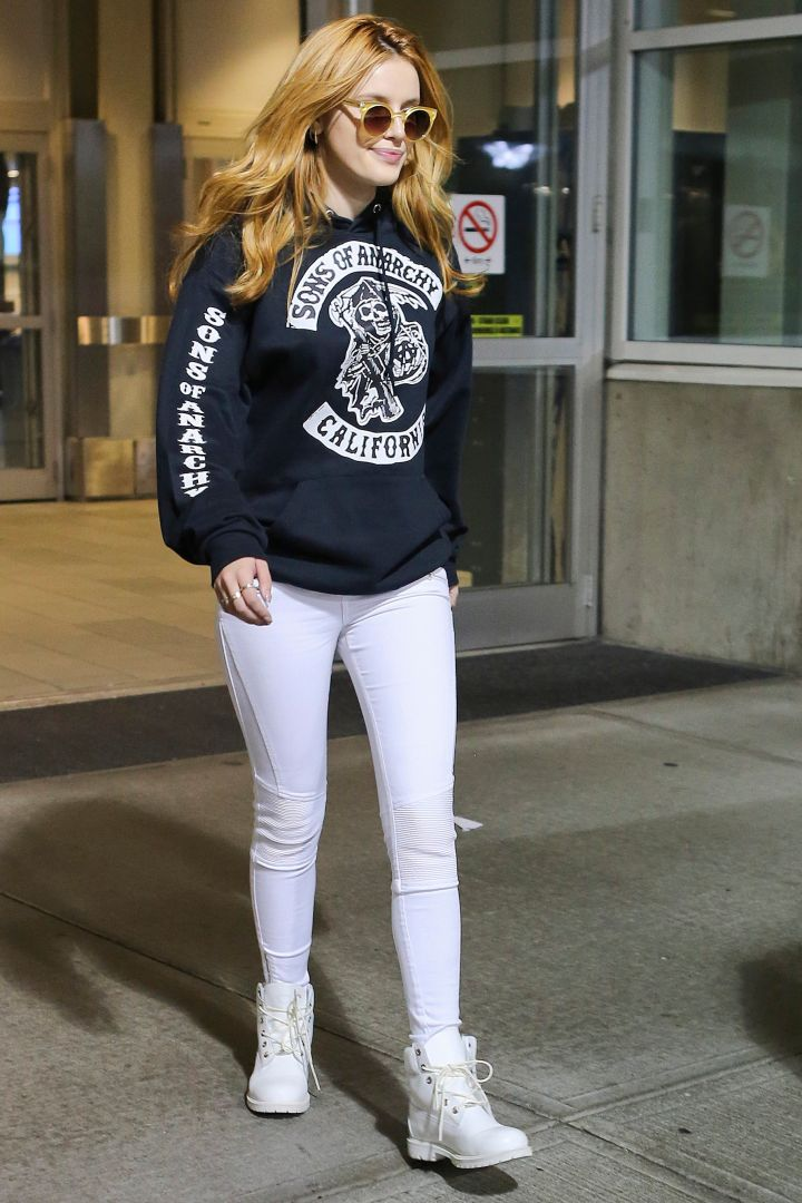 """Bella Thorne arrives in Vancouver to start production on """"Midnight Sun"""" rocking the perfect Netflix and Chill outfit in a """"Sons of Anarchy"""" hoodie. Let's binge watch together."""