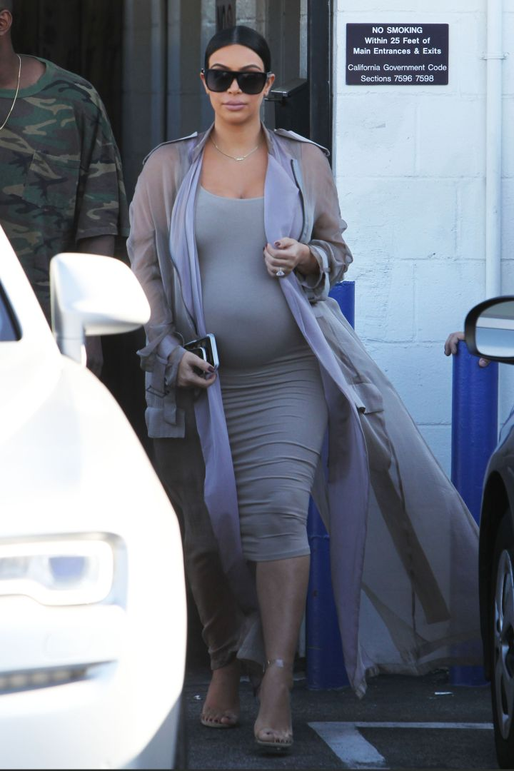 """Kim Kardashian wore fifty shades of gray while leaving the studio with Kanye West after filming """"Keeping Up with the Kardashians"""" in Los Angeles."""
