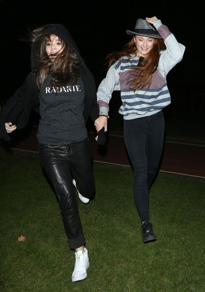 """So cool. """"Game Of Thrones"""" star Sophie Turner and pal Hailee Steinfeld run out to meet fans in London's Hyde Park. They signed autographs and posed for pictures with fans."""