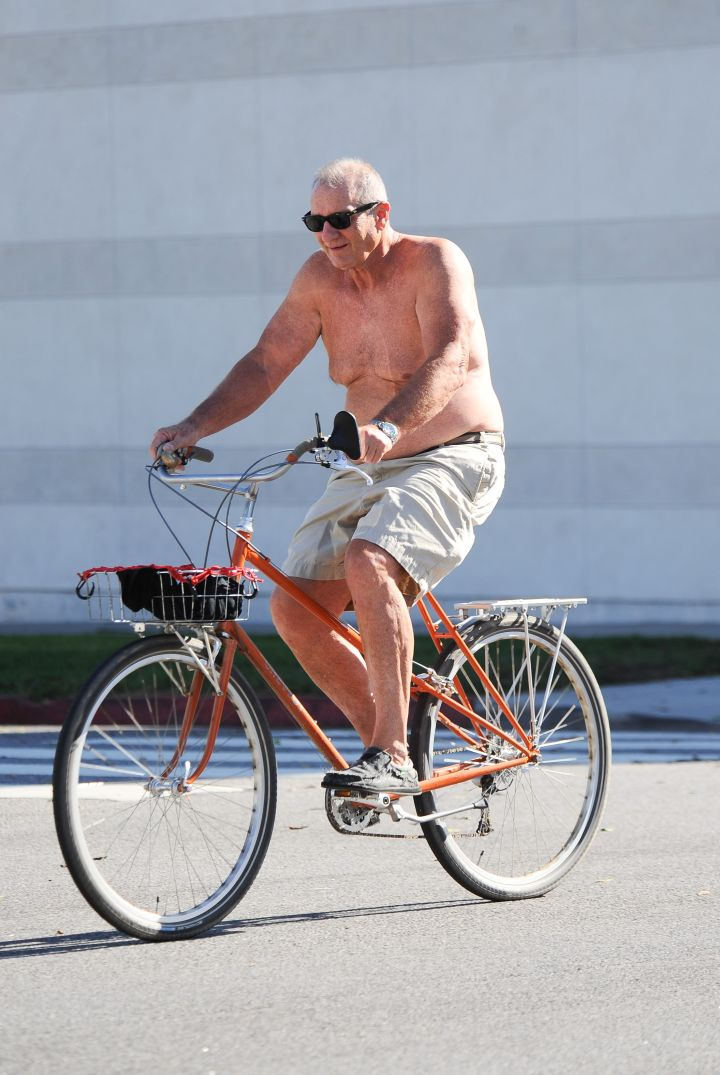 This is Ed O'Neill to some people, but to others it's a picture of Al Bundy riding a bike shirtless.