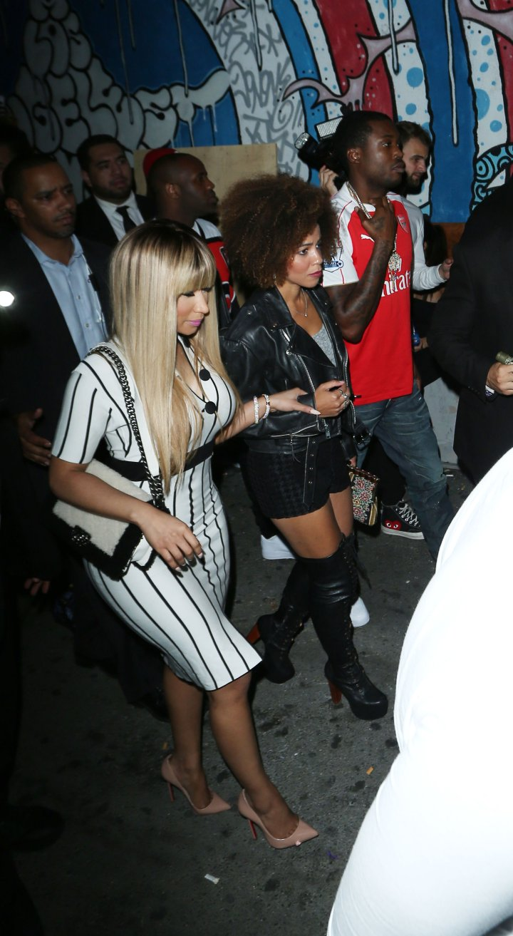 Nicki Minaj leaves with another young lady as her boyfriend Meek Mill follows behind them after partying at Playhouse nighclub in Hollywood. He is not holding her bag.