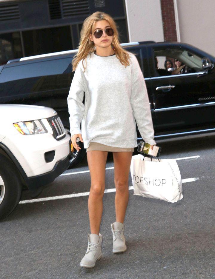 Hailey Baldwin showed off lengthy legs in her oversized sweater dress