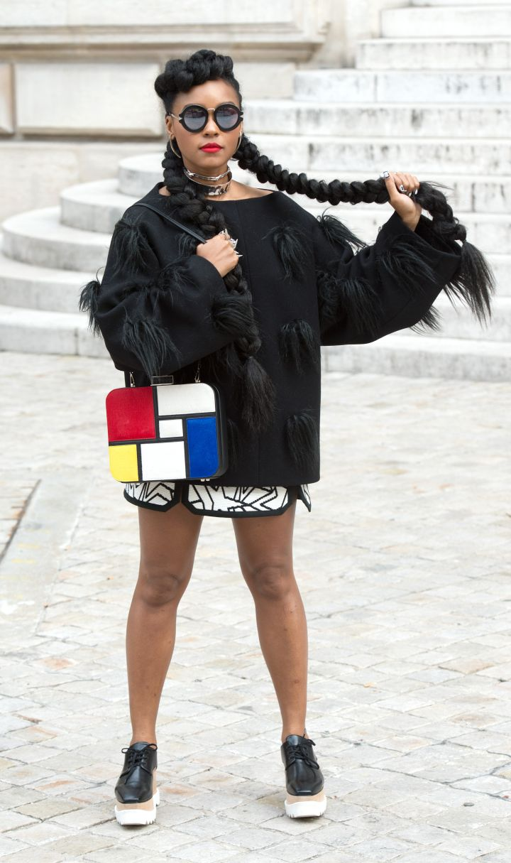 Janelle Monae is really switching up her style. Check her out at the Stella McCartney Spring/Summer 2016 fashion show at Paris Fashion Week.