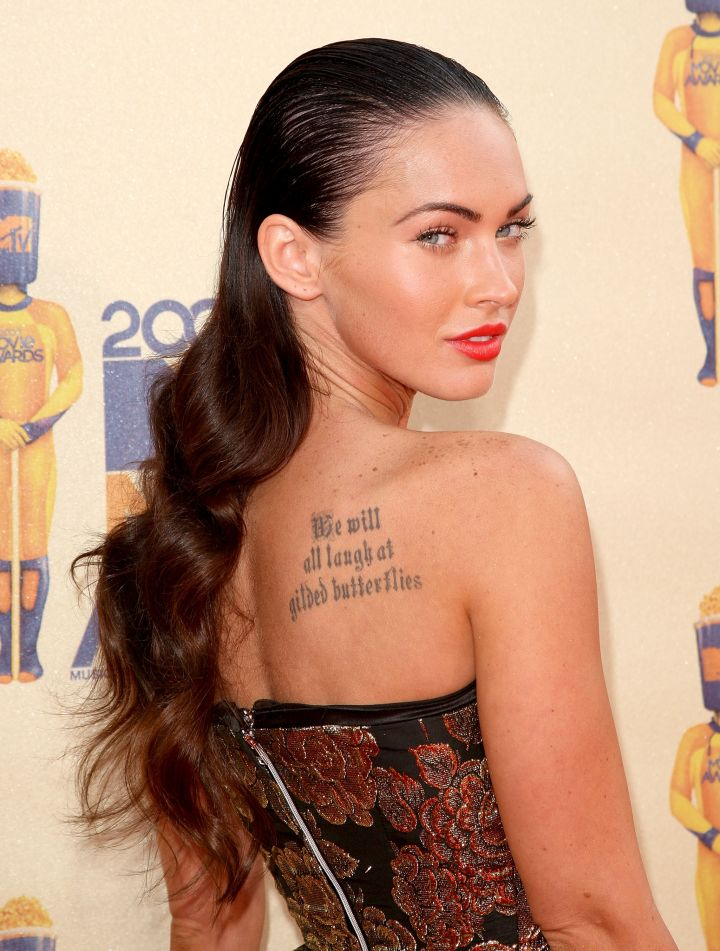"Megan Fox's tattoo, ""We will all laugh at gilded butterflies,"" is an adaptation of a quote from King Lear by William Shakespeare."