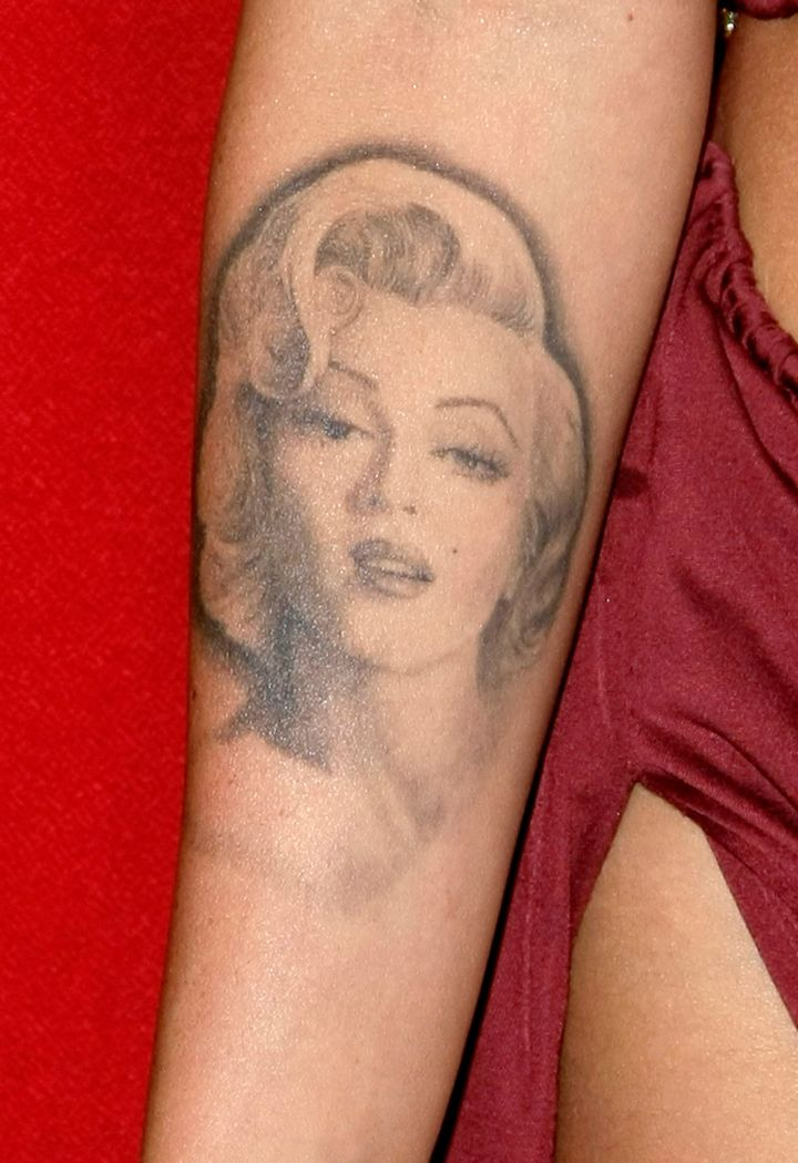 Megan has started laser surgery to remove her infamous Marilyn Monroe tattoo.