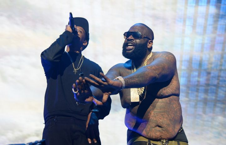 Rick Ross throws up the Roc sign as Hov spits his lyrics and dabs.