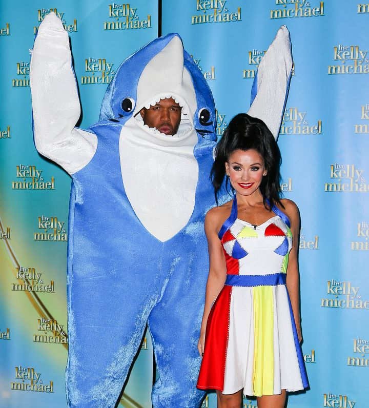 Michael Strahan and Kelly Ripa kicked off their show in costume – Left Shark and Katy Perry.