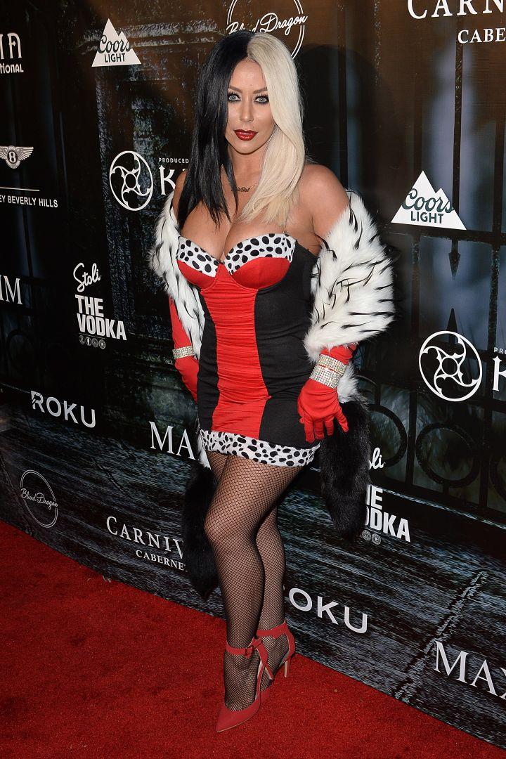 Aubrey O'Day as a slutty Cruella De Vil.