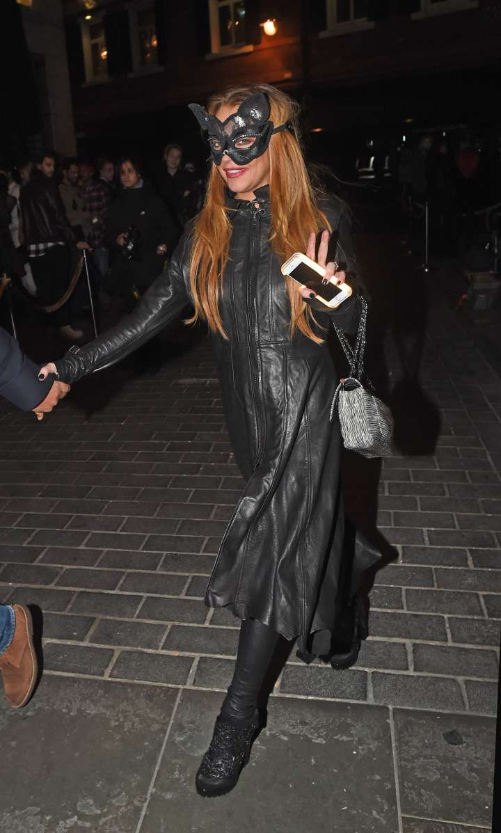 Lindsay Lohan rocked a sheer lace bodysuit with cat ears.