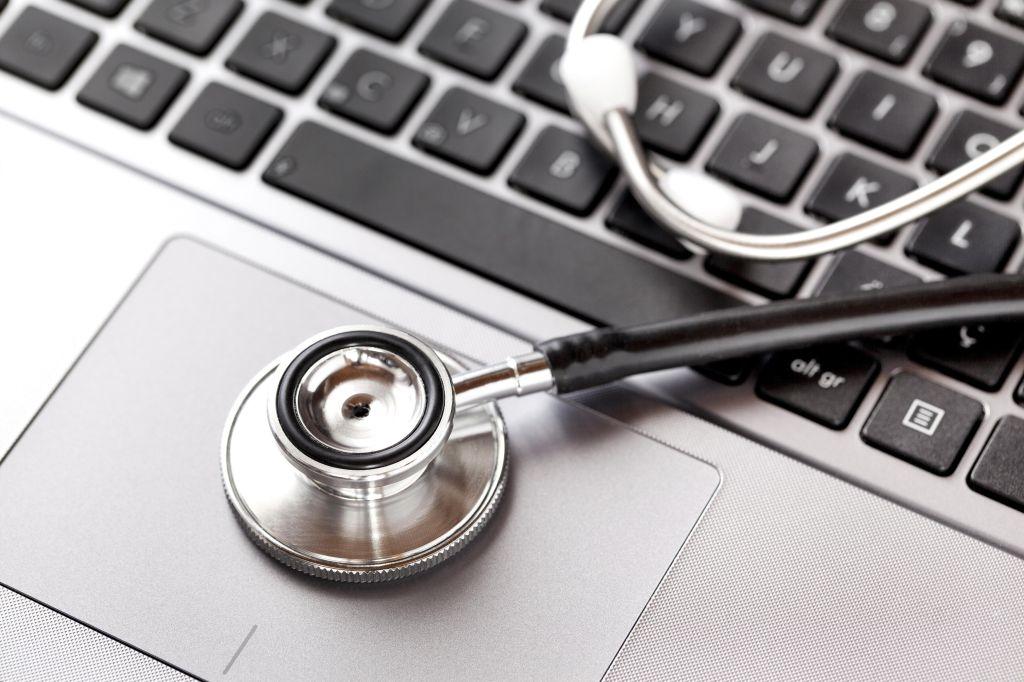 Close up of stethoscope on laptop