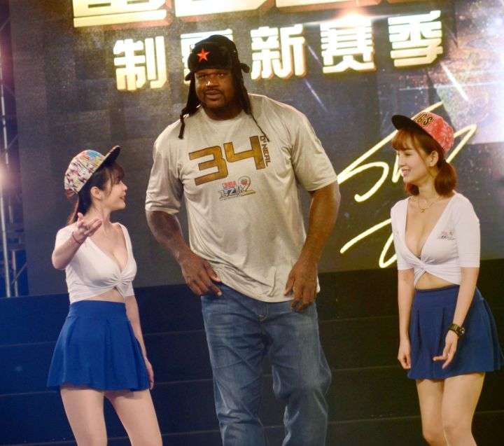 Shaq and two women.