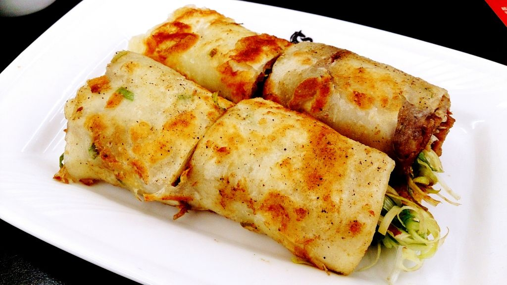 High Angle View Of Burrito Served In Plate