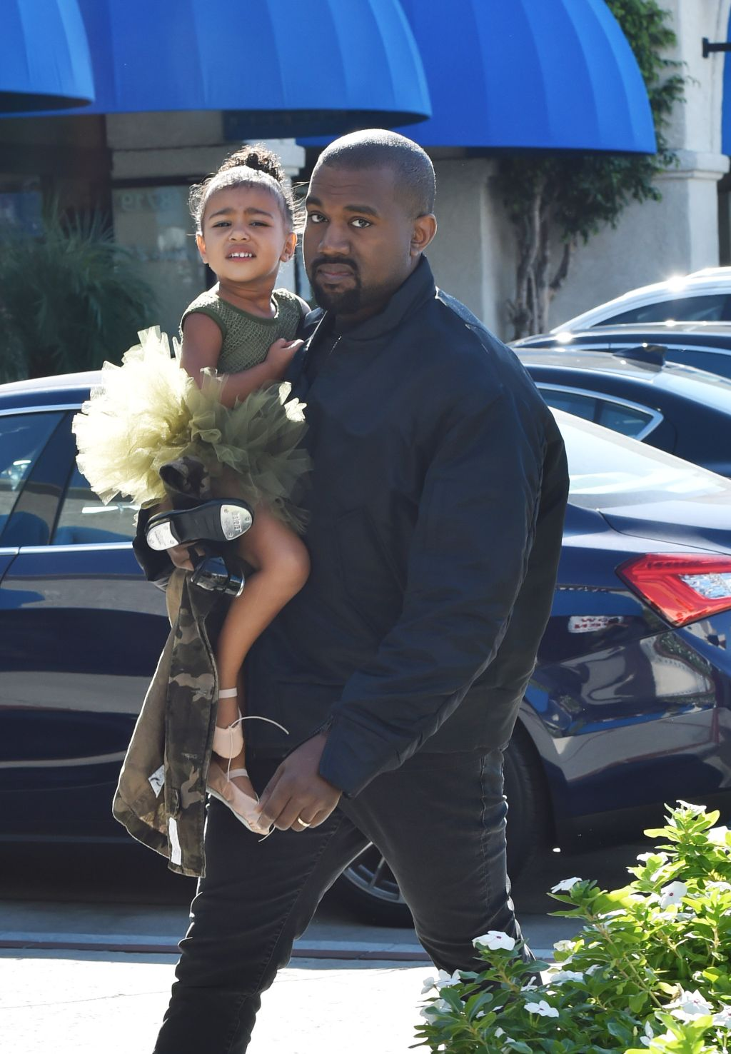 Kanye West picks up North West from dance class