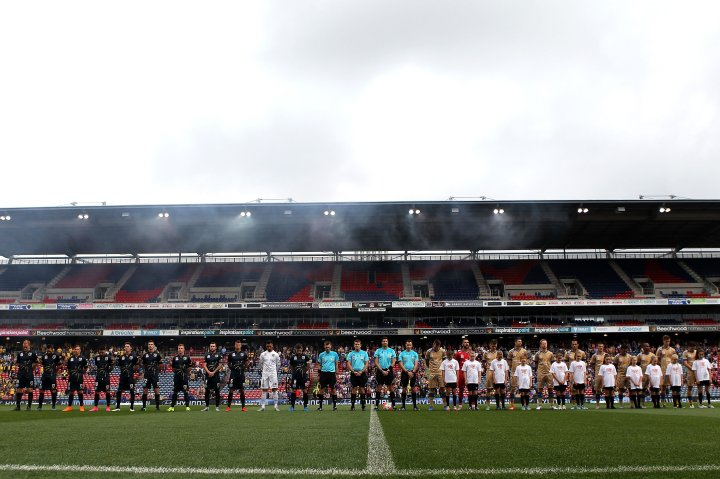 Players and officials have a moment of silence for victims during the Newcastle v. Central Coast round 6 A-league match.