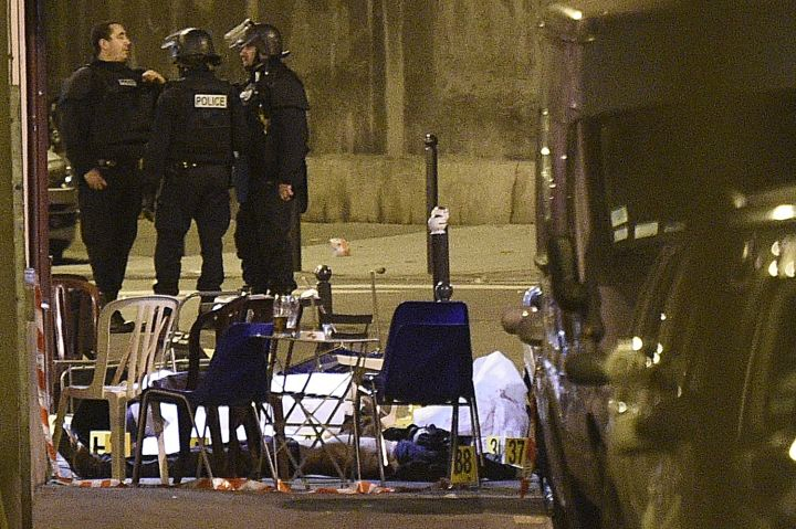 Victims lie on the ground after an attack on Rue Bichat in Central Paris.