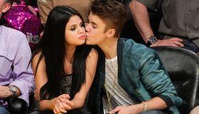 Justin Bieber and Selena Gomez kiss courtside