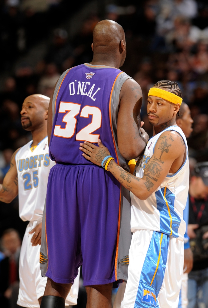 (KG NUGGETS_SUNS -- Nuggets guard Allen Iverson exchanged pleasantries with Phoenix center Shaquille O'Neal before Wednesday's matchup in Denver. The Denver Nuggets hosted the Phoenix Suns Wedensday, March 5, 2008 at the Pepsi Center. The Denver Post/ Kar