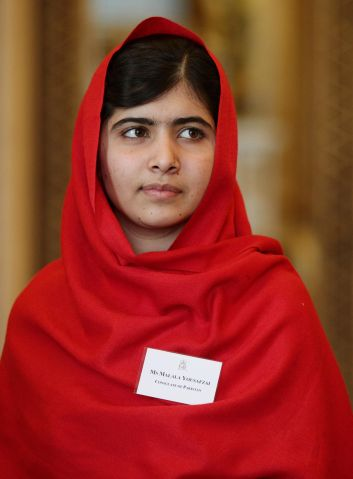 Queen Elizabeth II Receives Malala At Buckingham Palace