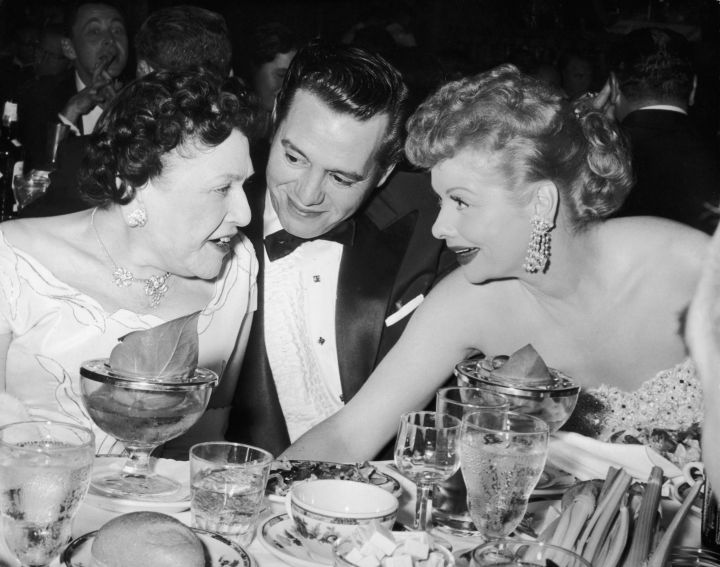 Lucille Ball and husband Desi Arnez chatted during a break in 1956.
