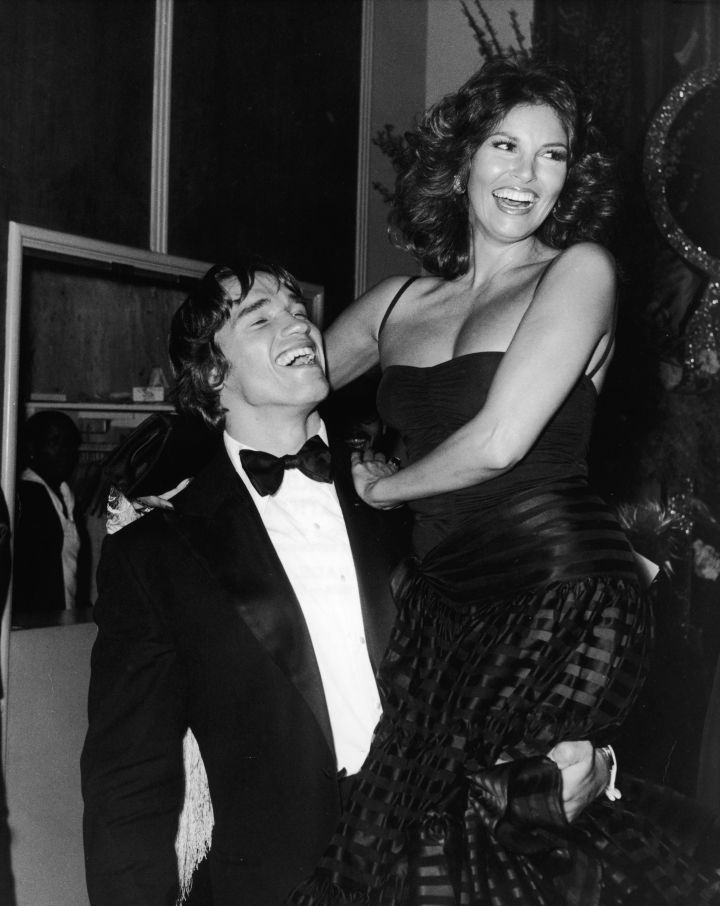 A young Arnold Schwarzenegger shared laughs with Raquel Welch in 1977.