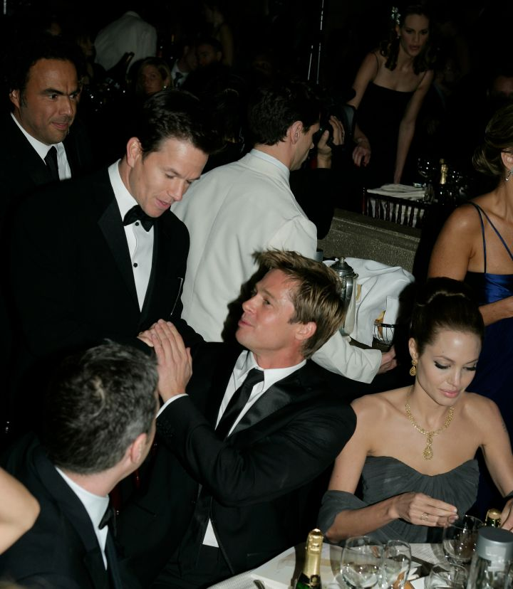 Mark Walhberg greeted Brad and Angelina at their table.