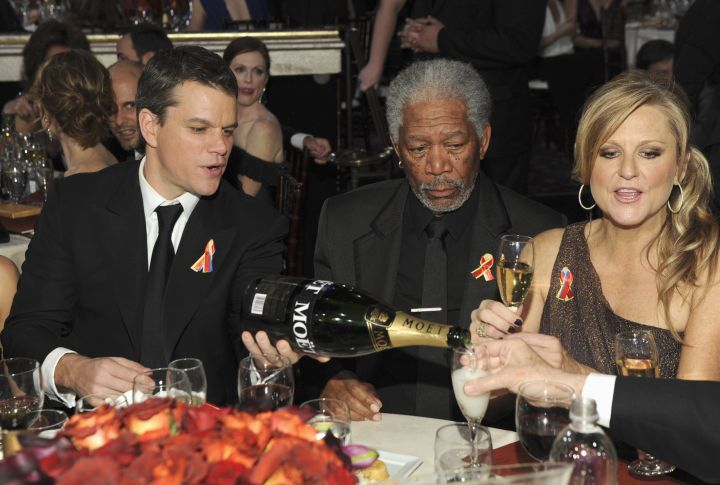 Matt Damon blessed Morgan Freeman and the rest of the table with some champagne.