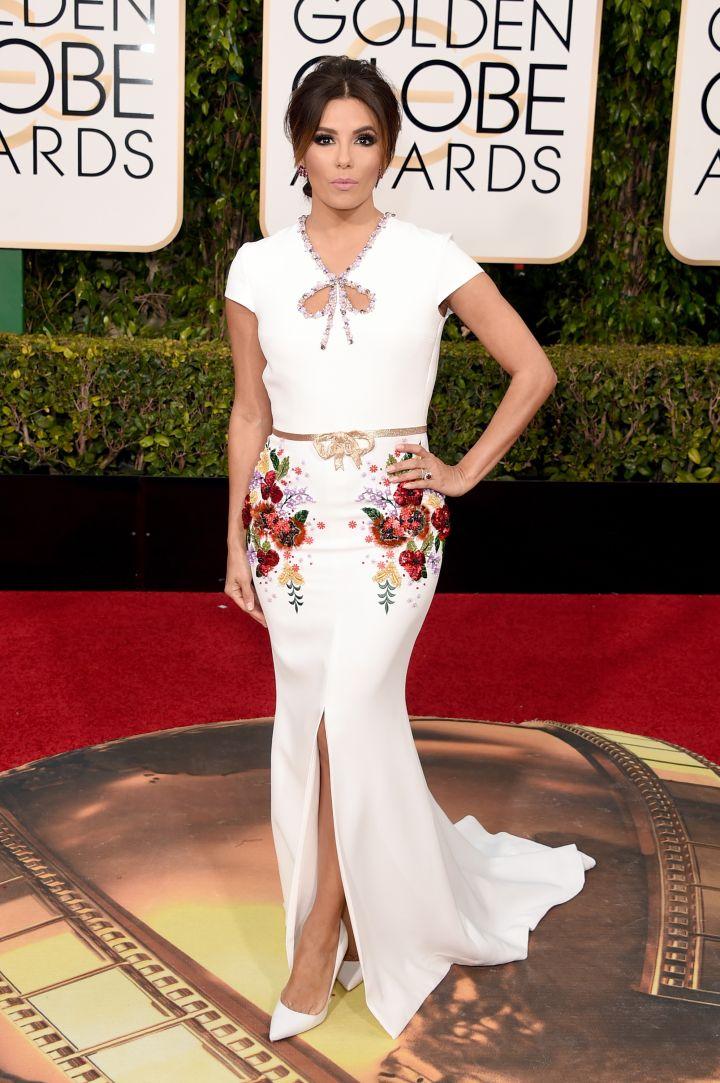 Eva Longoria rocked winter white with floral embellishments.