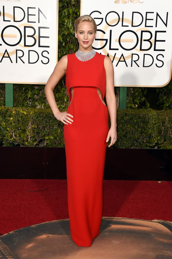 Jennifer Lawrence's striking red gown hugged her figure in all the right places.