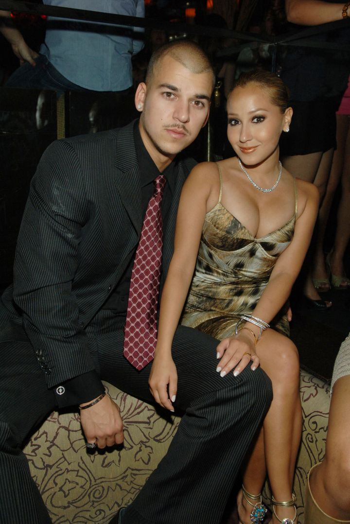 His first high profile relationship was with Adrienne Bailon, who famously got his name tatted and recently removed.