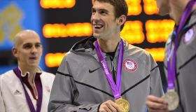 US swimmer Michael Phelps (C) shows off