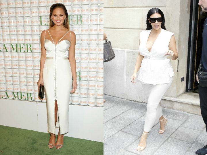Chrissy wore her white gown on the green carpet, while Kim rocked hers for the concrete catwalk in Paris.
